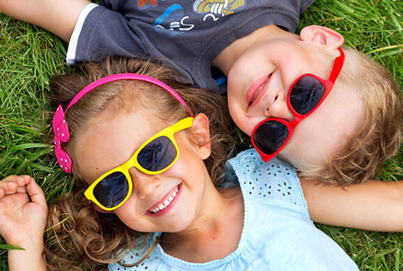 Kids with Glasses Smiling at Kitsap Kids Dentistry